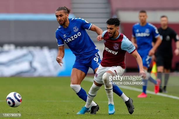 Everton's English striker Dominic Calvert-Lewin vies for the ball against West Ham United's Algerian midfielder Said Benrahma during the English...