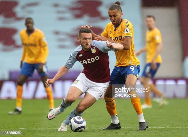 Everton's English striker Dominic Calvert-Lewin vies with Aston Villa's Scottish midfielder John McGinn during the English Premier League football...