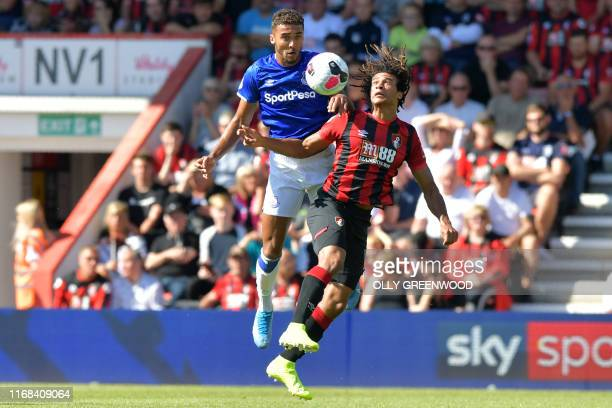 Everton's English striker Dominic CalvertLewin vies with Bournemouth's Dutch defender Nathan Ake during the English Premier League football match...