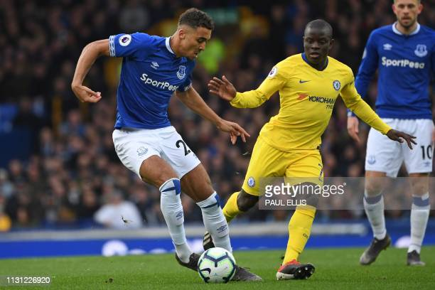 Everton's English striker Dominic CalvertLewin vies with Chelsea's French midfielder N'Golo Kante during the English Premier League football match...
