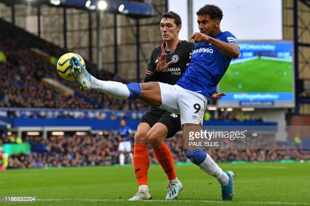 Everton's English striker Dominic CalvertLewin vies with Chelsea's Danish defender Andreas Christensen during the English Premier League football...