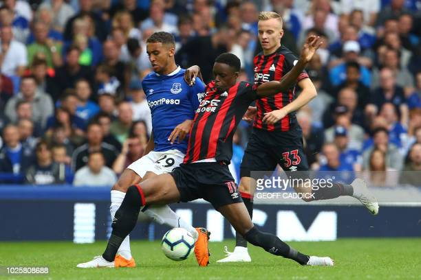 Everton's English striker Dominic CalvertLewin vies with Huddersfield Town's French striker Adama Diakhaby during the English Premier League football...