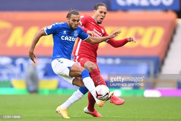 Everton's English striker Dominic Calvert-Lewin vies with Liverpool's Dutch defender Virgil van Dijk during the English Premier League football match...