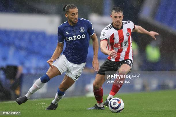 Everton's English striker Dominic Calvert-Lewin vies with Sheffield United's English defender Jack Robinson during the English Premier League...