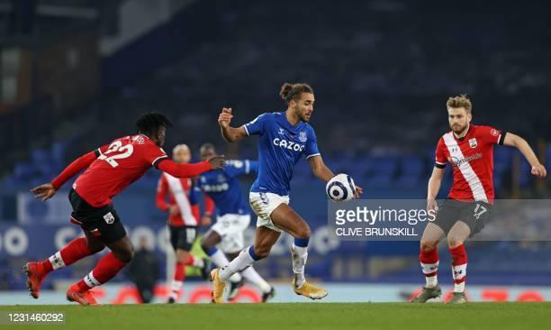 Everton's English striker Dominic Calvert-Lewin vies with Southampton's Ghanaian defender Mohammed Salisu and Southampton's Scottish midfielder...