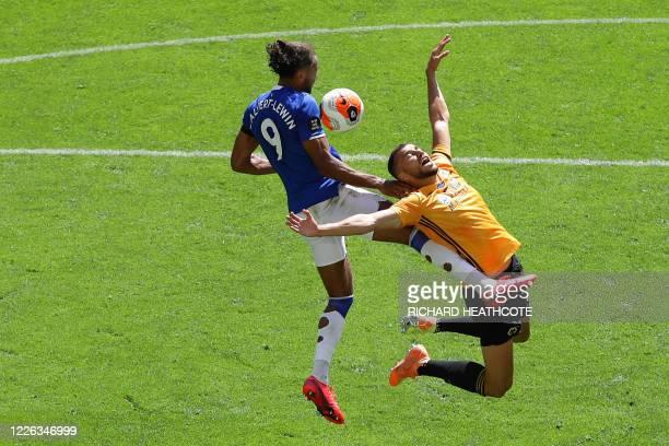 Everton's English striker Dominic Calvert-Lewin vies with Wolverhampton Wanderers' Moroccan midfielder Romain Saiss during the English Premier League...