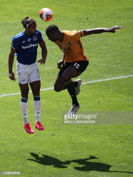 Everton's English striker Dominic Calvert-Lewin vies with Wolverhampton Wanderers' French defender Willy Boly during the English Premier League...