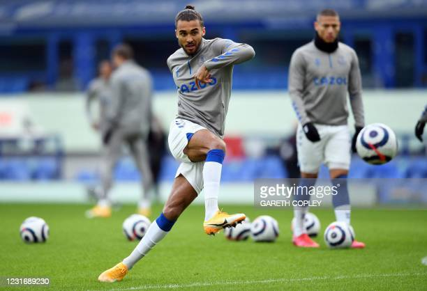 Everton's English striker Dominic Calvert-Lewin warms up for the English Premier League football match between Everton and Burnley at Goodison Park...