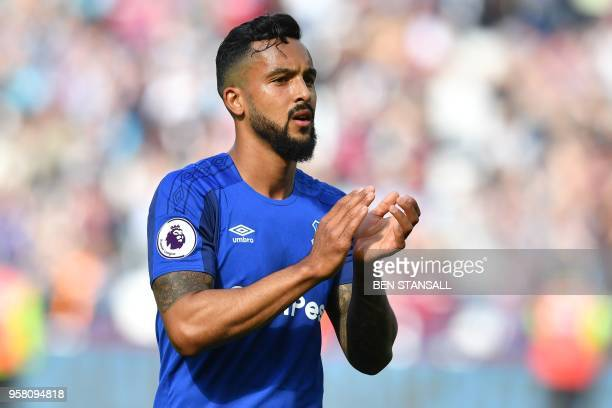 Everton's English striker Theo Walcott applauds supporters on the pitch after the English Premier League football match between West Ham United and...