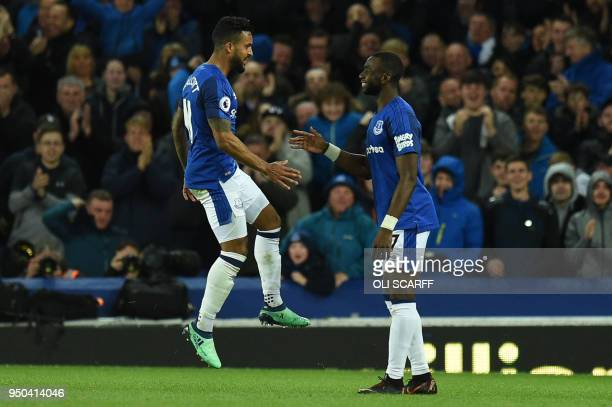 Everton's English striker Theo Walcott celebrates scoring the opening goal during the English Premier League football match between Everton and...