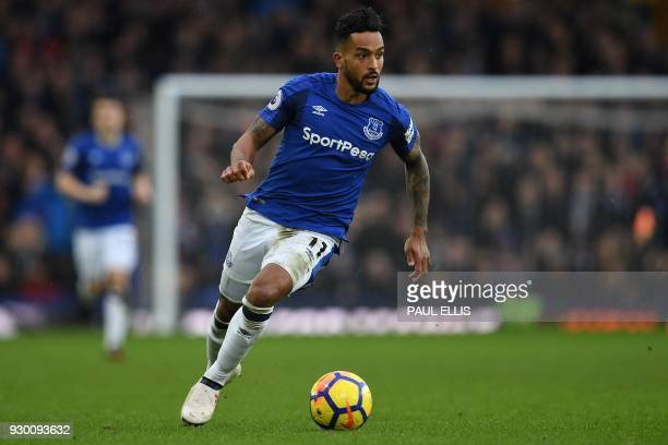Everton's English striker Theo Walcott controls the ball during the English Premier League football match between Everton and Brighton and Hove...