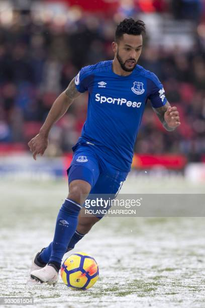 Everton's English striker Theo Walcott controls the ball during the English Premier League football match between Stoke City and Everton at the...