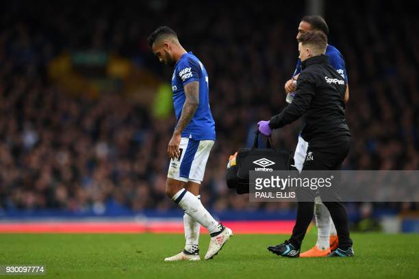 Everton's English striker Theo Walcott leaves the pitch injured during the English Premier League football match between Everton and Brighton and...