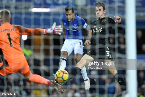 Everton's English striker Theo Walcott shoots past Leicester City's Danish goalkeeper Kasper Schmeichel to score their second goal during the English...