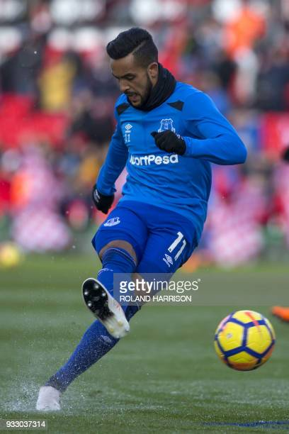 Everton's English striker Theo Walcott warms up before the English Premier League football match between Stoke City and Everton at the Bet365 Stadium...