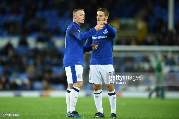 Everton's English striker Wayne Rooney and Everton's Croatian striker Nikola Vlasic interact during the UEFA Europa League Group E football match...