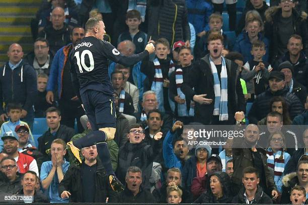 TOPSHOT Everton's English striker Wayne Rooney celebrates scoring his team's goal during the English Premier League football match between Manchester...