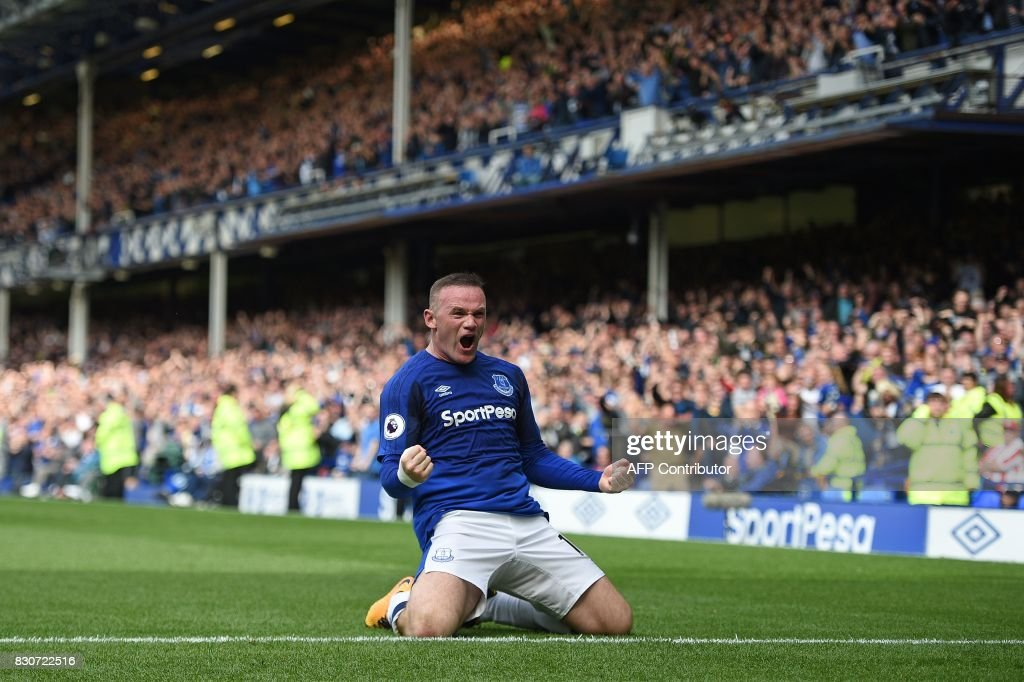 Everton's English striker Wayne Rooney celebrates scoring the opening goal during the English Premier League football match between Everton and Stoke City at Goodison Park in Liverpool, north west England on August 12, 2017. / AFP PHOTO / Oli SCARFF / RESTRICTED TO EDITORIAL USE. No use with unauthorized audio, video, data, fixture lists, club/league logos or 'live' services. Online in-match use limited to 75 images, no video emulation. No use in betting, games or single club/league/player publications. /
