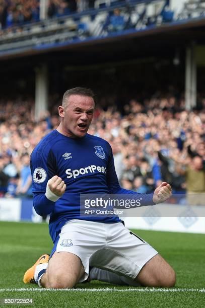 Everton's English striker Wayne Rooney celebrates scoring the opening goal during the English Premier League football match between Everton and Stoke...