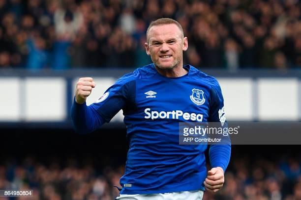 Everton's English striker Wayne Rooney celebrates scoring the opening goal during the English Premier League football match between Everton and...