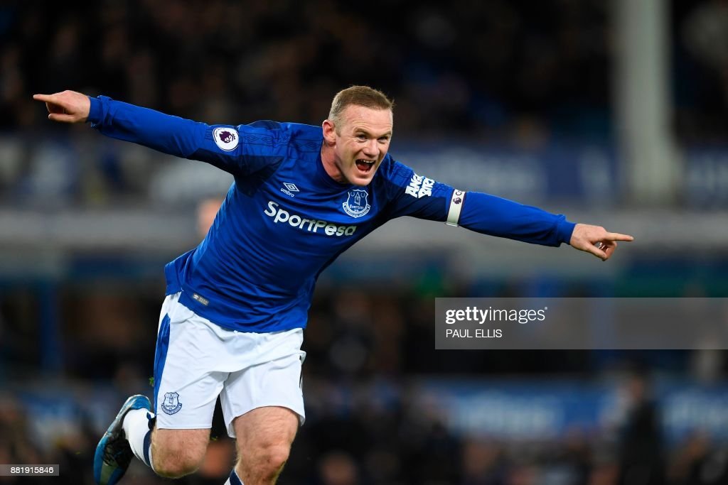 TOPSHOT - Everton's English striker Wayne Rooney celebrates scoring their second goal during the English Premier League football match between Everton and West Ham United at Goodison Park in Liverpool, north west England on November 29, 2017. / AFP PHOTO / Paul ELLIS / RESTRICTED TO EDITORIAL USE. No use with unauthorized audio, video, data, fixture lists, club/league logos or 'live' services. Online in-match use limited to 75 images, no video emulation. No use in betting, games or single club/league/player publications. /