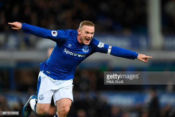 TOPSHOT Everton's English striker Wayne Rooney celebrates scoring their second goal during the English Premier League football match between Everton...