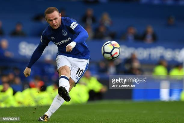 TOPSHOT Everton's English striker Wayne Rooney crosses the ball during the English Premier League football match between Everton and Burnley at...