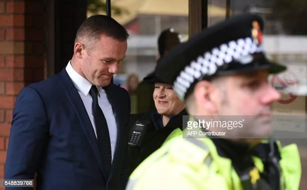 Everton's English striker Wayne Rooney leaves after attending Stockport Magsitrates Court in Stockport northwest England on September 18 2017 Former...