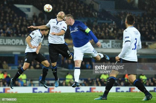 Everton's English striker Wayne Rooney misses a chance at goal past Atalanta's Italian defender Andrea Masiello during the UEFA Europa League Group E...