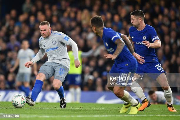 Everton's English striker Wayne Rooney passes the ball during the English League Cup fourth round football match between Chelsea and Everton at...