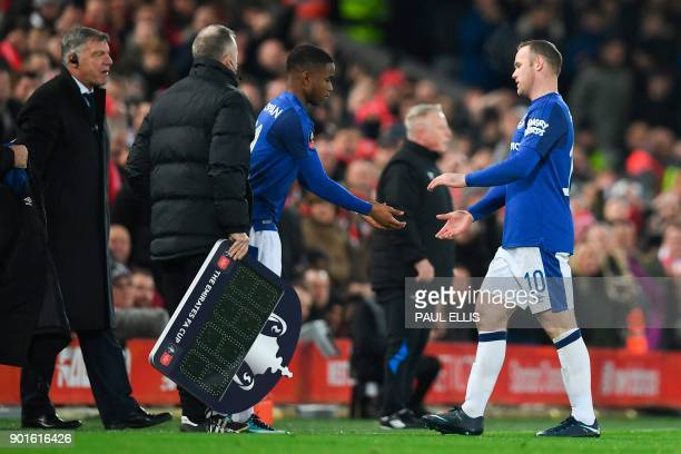 Everton's English striker Wayne Rooney shakes hands with Everton's English striker Ademola Lookman as Lookman replaces him during the English FA Cup...