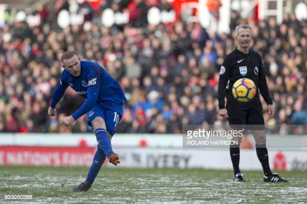 Everton's English striker Wayne Rooney takes a shot during the English Premier League football match between Stoke City and Everton at the Bet365...