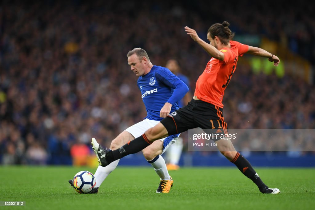 Everton's English striker Wayne Rooney (L) vies with MFK Ruzomberok's Matej Kochan during the UEFA Europa League third qualifying round, Game 1 match between Everton and Ruzomberok at Goodison Park football stadium in Liverpool on July 27, 2017. / AFP PHOTO / Paul ELLIS