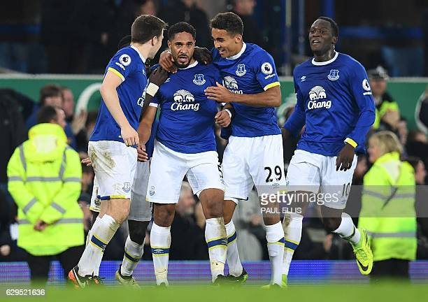 Everton's Englishborn Welsh defender Ashley Williams celebrates scoring his team's second goal during the English Premier League football match...