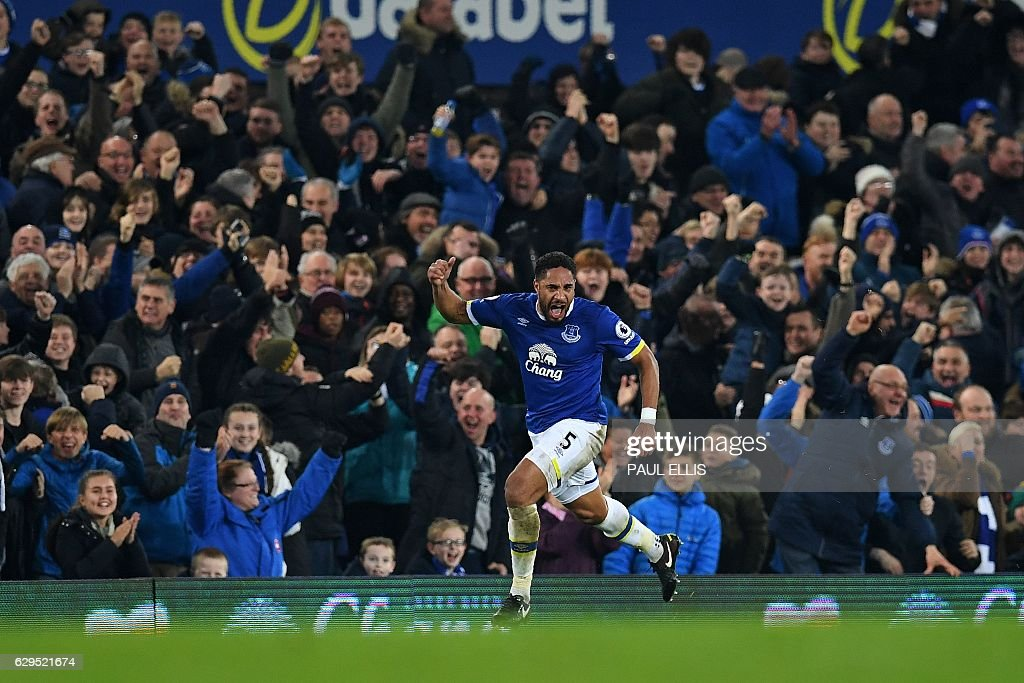 Everton's English-born Welsh defender Ashley Williams celebrates scoring his team's second goal during the English Premier League football match between Everton and Arsenal at Goodison Park in Liverpool, north west England on December 13, 2016. / AFP / Paul ELLIS / RESTRICTED TO EDITORIAL USE. No use with unauthorized audio, video, data, fixture lists, club/league logos or 'live' services. Online in-match use limited to 75 images, no video emulation. No use in betting, games or single club/league/player publications. /