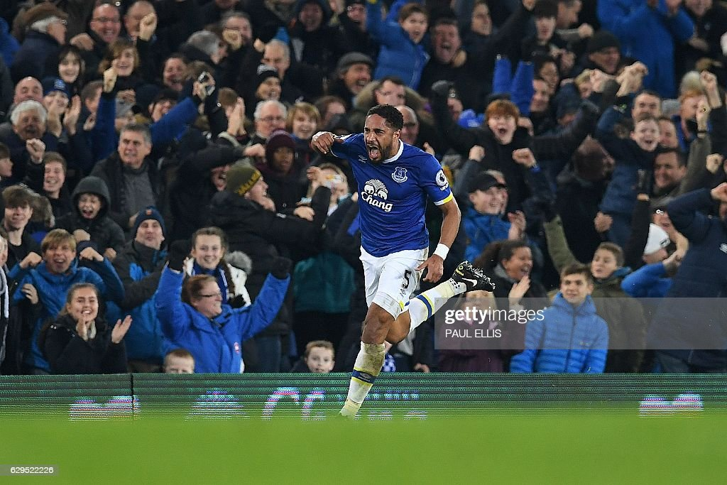 Everton's English-born Welsh defender Ashley Williams celebrates scoring his team's second goal during the English Premier League football match between Everton and Arsenal at Goodison Park in Liverpool, north west England on December 13, 2016. Everton won the match 2-1. / AFP / Paul ELLIS / RESTRICTED TO EDITORIAL USE. No use with unauthorized audio, video, data, fixture lists, club/league logos or 'live' services. Online in-match use limited to 75 images, no video emulation. No use in betting, games or single club/league/player publications. /