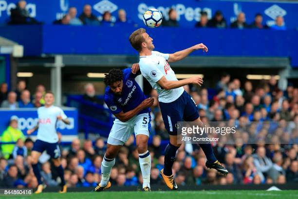 Everton's Englishborn Welsh defender Ashley Williams challenges Tottenham Hotspur's English striker Harry Kane for a header during the English...