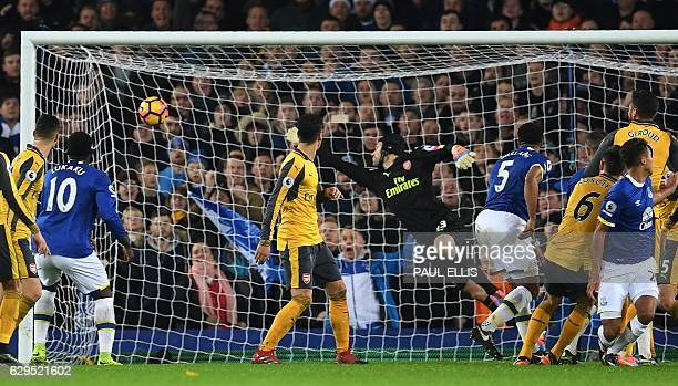 Everton's Englishborn Welsh defender Ashley Williams scores his team's second goal during the English Premier League football match between Everton...