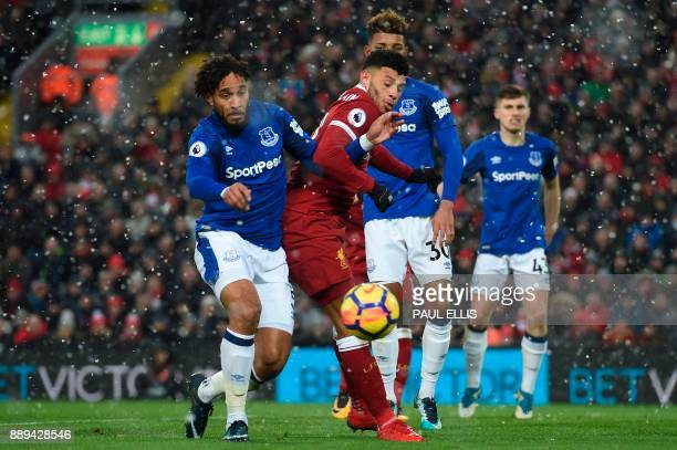 Everton's Englishborn Welsh defender Ashley Williams tangles with Liverpool's English midfielder Alex OxladeChamberlain during the English Premier...