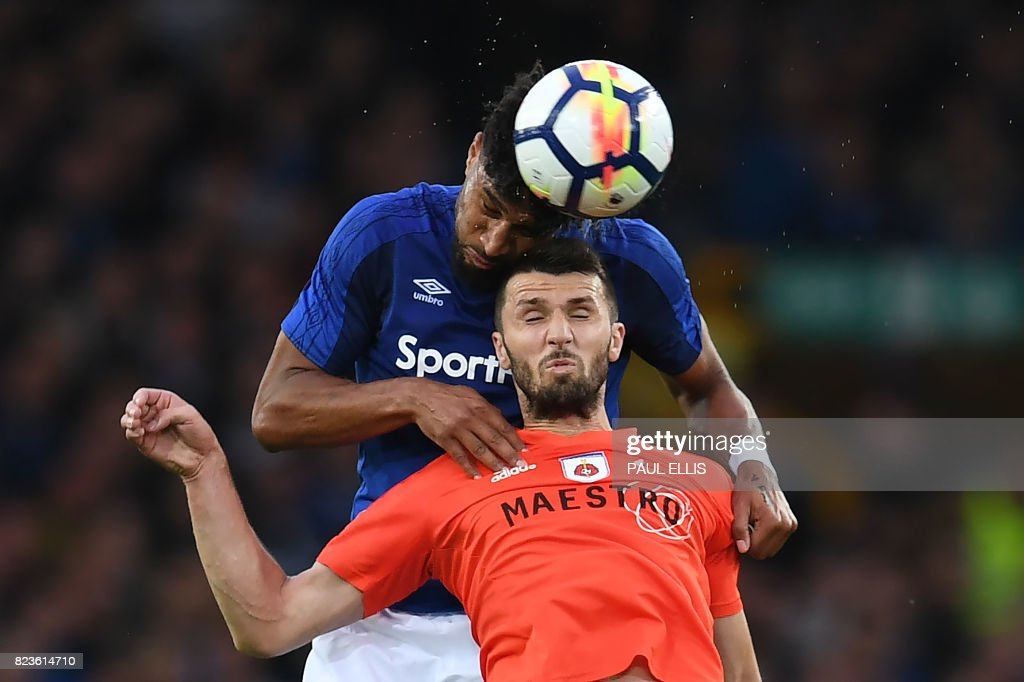 Everton's English-born Welsh defender Ashley Williams (L) vies with MFK Ruzomberok's Nermin Haskic during the UEFA Europa League third qualifying round, Game 1 match between Everton and Ruzomberok at Goodison Park football stadium in Liverpool on July 27, 2017. / AFP PHOTO / Paul ELLIS