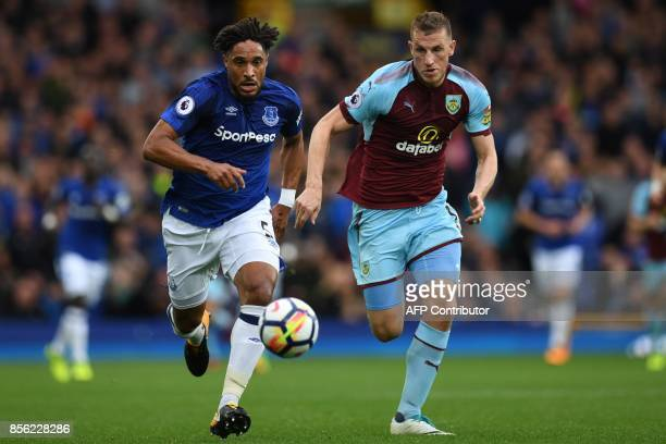 Everton's Englishborn Welsh defender Ashley Williams vies with Burnley's New Zealand striker Chris Wood during the English Premier League football...