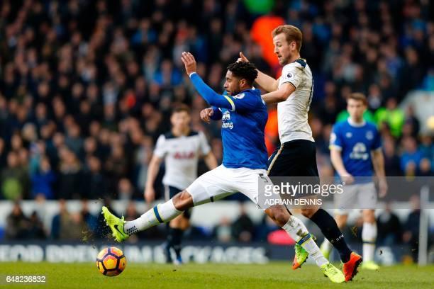 Everton's Englishborn Welsh defender Ashley Williams vies with Tottenham Hotspur's English striker Harry Kane during the English Premier League...