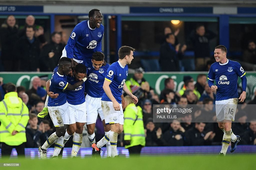 Everton's English-born Welsh defender Ashley Williams with Everton's Belgian striker Romelu Lukaku celebrates scoring his team's second goal during the English Premier League football match between Everton and Arsenal at Goodison Park in Liverpool, north west England on December 13, 2016. Everton won the match 2-1. / AFP / Paul ELLIS / RESTRICTED TO EDITORIAL USE. No use with unauthorized audio, video, data, fixture lists, club/league logos or 'live' services. Online in-match use limited to 75 images, no video emulation. No use in betting, games or single club/league/player publications. /