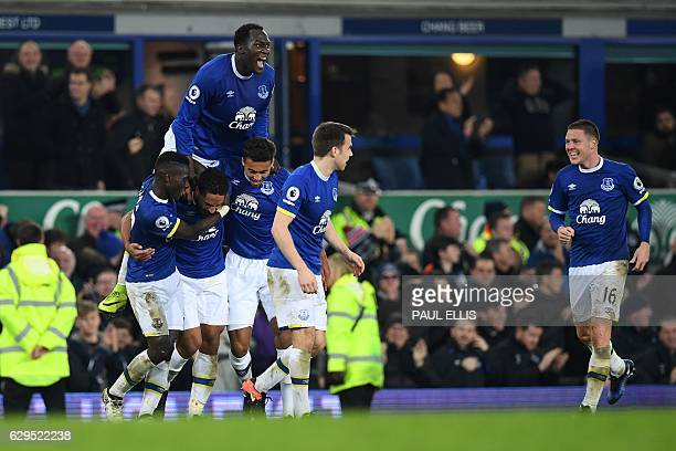 Everton's Englishborn Welsh defender Ashley Williams with Everton's Belgian striker Romelu Lukaku celebrates scoring his team's second goal during...