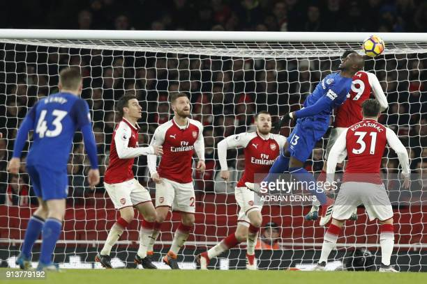 Everton's French defender Eliaquim Mangala heads in the goal area during the English Premier League football match between Arsenal and Everton at the...