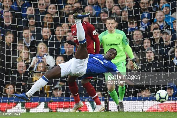 Everton's French defender Kurt Zouma clears the ball during the English Premier League football match between Everton and Liverpool at Goodison Park...