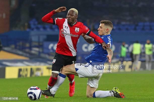 Everton's French defender Lucas Digne fouls Southampton's Malian midfielder Moussa Djenepo during the English Premier League football match between...