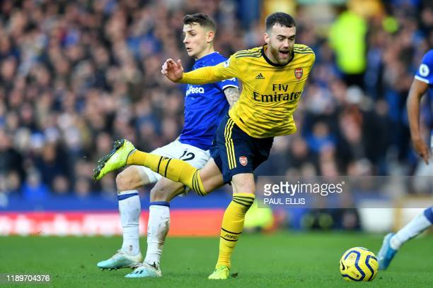 Everton's French defender Lucas Digne vies with Arsenal's English defender Calum Chambers during the English Premier League football match between...