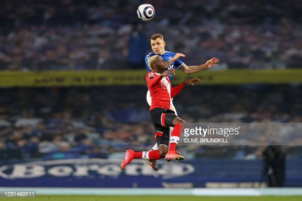 Everton's French defender Lucas Digne vies with Southampton's Malian midfielder Moussa Djenepo during the English Premier League football match...
