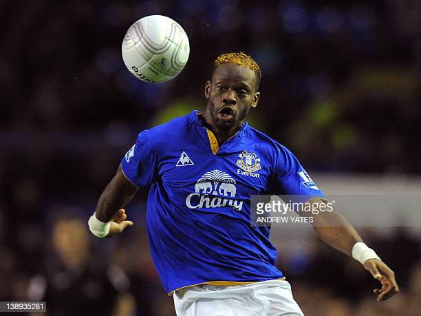 Everton's French forward Louis Saha eyes the ball during the League Cup football match between Everton and Chelsea at Goodison Park in Liverpool,...
